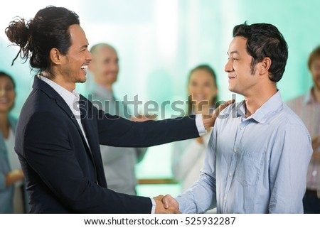 Joyful Businessmen Shaking Hands after Meeting
