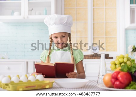 Joyful child is ready to cook