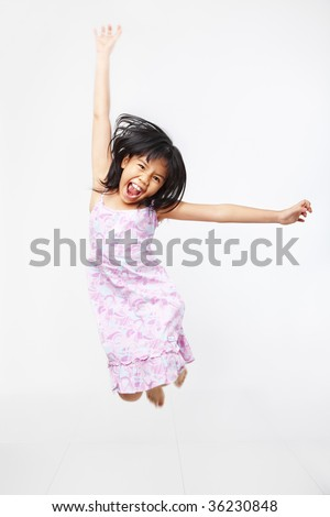 Joyful kid jumping high over white background. PS : motion blur