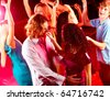 Joyful teens dancing in night club at party - stock photo