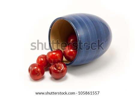 Juicy ruby red cherries in a blue cup
