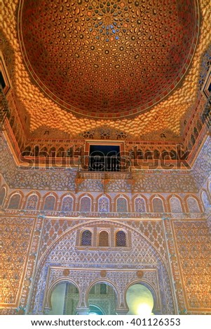 JUL 11 2015: Moorish decorations on the walls and ceiling of the Alcazar of Seville in Seville, Andalusia, Spain
