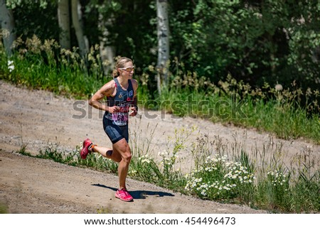 July 16, 2016 - Beaver Creek, Colorado, USA: Katharine Carter runs to fourth place in the women's race at the XTERRA Beaver Creek Mountain Championship.