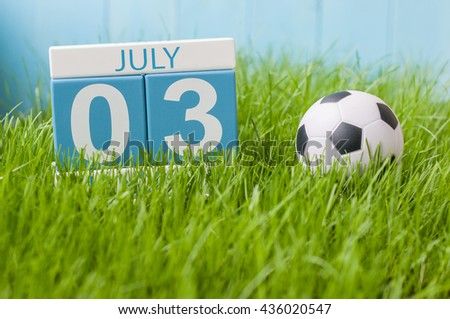 July 3rd. Image of july 3 wooden color calendar on green lawn grass background. Summer day