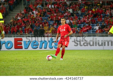 July 24, 2015- Shah Alam, Malaysia: Liverpool's Dejan Lovren passes the ball in a friendly match against the Malaysian Team. Liverpool Football Club from England is on an Asia tour.