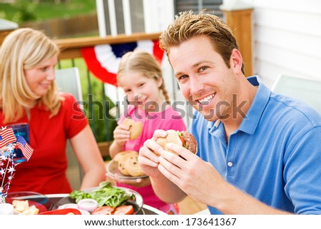 July 4th: Smiling Dad At Outdoors Cookout Dinner