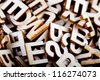 Jumbled wooden letters close up - stock photo