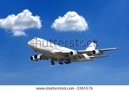 Jumbo jet and two clouds on a blue sky