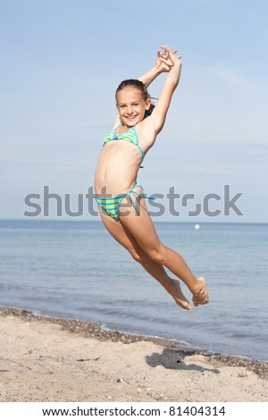 Jumping Girl At The Beach Stock Photo