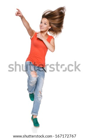 Jumping girl pointing to the side over white background