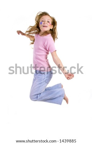 jumping happy girl in pink tshirt and blue jeans