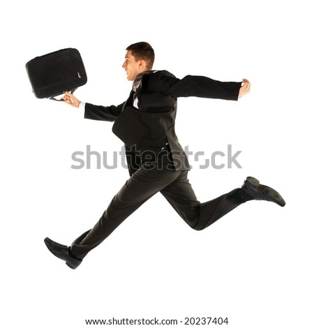 jumping young manager in suit on white