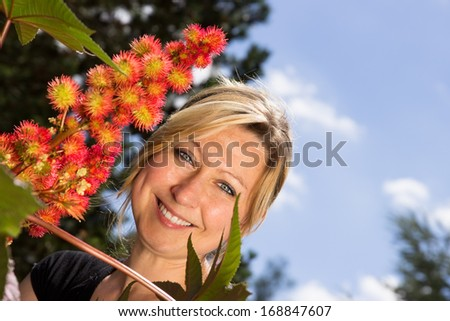 Jung attractive female smiling beside a moringa