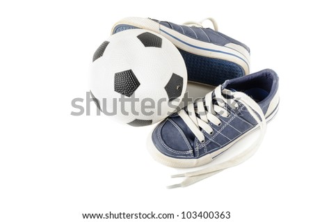 Junior soccer ball with kids' shoes isolated on white