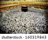 Kaaba in Mecca, Muslim people praying together at holy place - stock photo