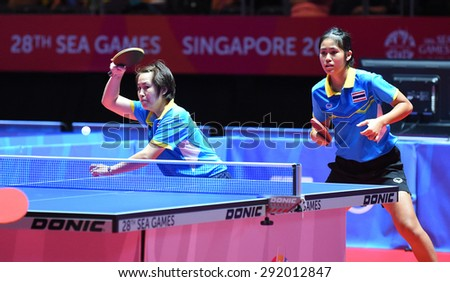 KALLANG,SINGAPORE-JUNE1:Nanthana.K and Suthasini.S of Thailand in action during the 28th SEA Games Singapore 2015 between Thailand and Indonesia at Singapore Indoor Stadium on June1 2015 in SINGAPORE.
