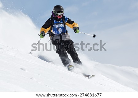 "KAMCHATKA, RUSSIA - MARCH 9, 2014: Skier rides steep mountains. Competitions freeride skiers and snowboarders ""Kamchatka Freeride Open Cup"". Russia, Far East, Kamchatka Peninsula."