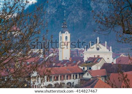 Kamnik, Slovenia - January 25, 2016. Church of the Immaculate Conception with its Tower among red roofs of the town.