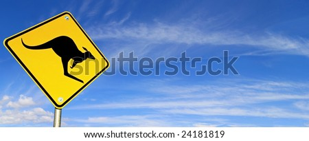 Kangaroo Warning Sign with panoramic blue sky behind.