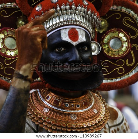 KANNUR - DECEMBER 11: An unidentified Theyyam performer at a village performance on December 11, 2011 in Kannur, Kerala, south India.
