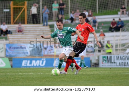 KAPOSVAR, HUNGARY - APRIL 28: Nikola Safaric (in green 8) in action at a Hungarian National Championship soccer game Kaposvar (green) vs Pecs (red) April 28, 2012 in Kaposvar, Hungary.