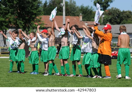 KAPOSVAR, HUNGARY - JULY 20: Unidentified winner players are glad at the V. Youth Football Festival match - July 20, 2009 in Kaposvar, Hungary.