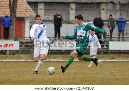 KAPOSVAR, HUNGARY - MARCH 5: Arpad Horvath (in green) in action at the Hungarian National Championship under 19 game between Kaposvar and MTK on March 5, 2011 in Kaposvar, Hungary.