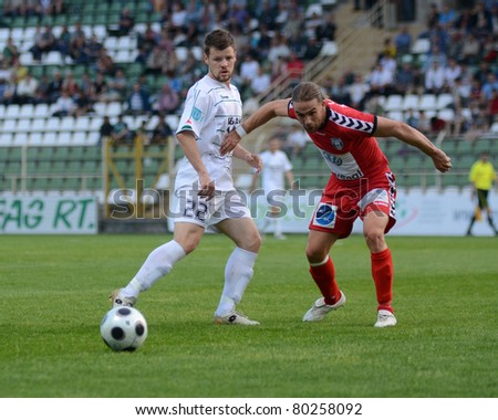 KAPOSVAR, HUNGARY - MAY 14: Bojan Pavlovic (in white 22) in action at a Hungarian National Championship soccer game - Kaposvar vs Szolnok on May 14, 2011 in Kaposvar, Hungary.