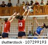 KAPOSVAR, HUNGARY - MAY 18: Petra Horvath (in blue) in action at the final of the hungarian junior volleyball championship (Kaposvar  blue vs. Budai XI  red) , May 18, 2012 in Kaposvar, Hungary - stock photo