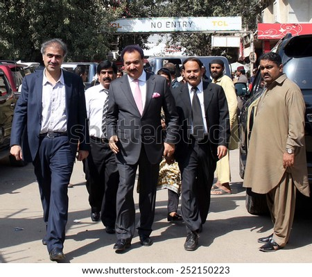 KARACHI, PAKISTAN - FEB 12: Peoples Party leader, Rehman Malik is coming to submit his nomination papers to election commissioner to take part in senate elections, on February 12, 2015 in Karachi.