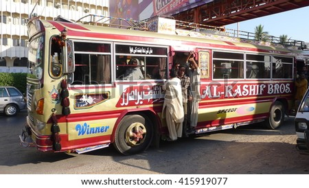 KARACHI, PAKISTAN - FEBRUARY 07: Bus art whereby the owners beautify the exterior and interior of the buses with glittering and colorful metallic and plastic sheets.  on February 07, 2016 in Karachi.