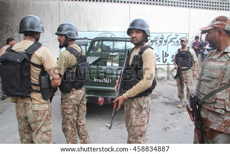 KARACHI, PAKISTAN - JUL 26: Security personnel are gathering at venue after firing incident, in Saddar area on July 26, 2016 in Karachi.