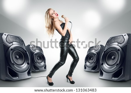 Karaoke singer at night in black leather clothing