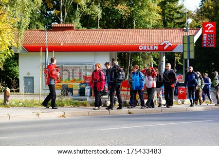 KARPACZ, POLAND - OCTOBER 05, 2013: Group of people walking with a guide on the street