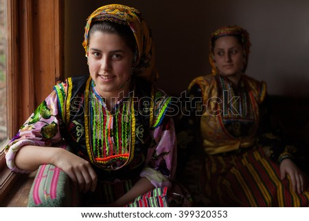Kastamonu,Turkey - November 27,2010: Unidentified young women in traditional dress.These colorful traditional clothing is very popular among women in rural areas of Kastamonu Province of Turkey.