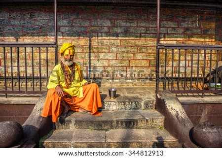 KATHMANDU, NEPAL - OCTOBER 21, 2015 : Wandering  Shaiva sadhu (holy man) with traditional face painting in ancient Pashupatinath Temple