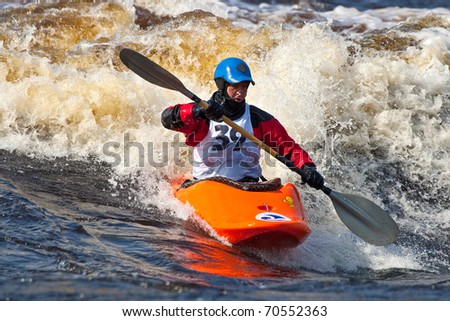Kayak freestyle on whitewater