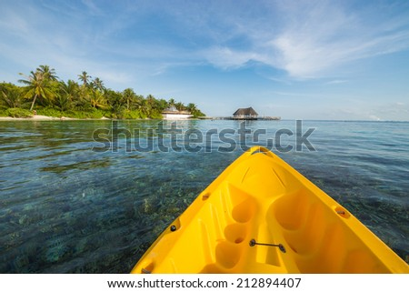 Kayaking around the island resort of Maldives