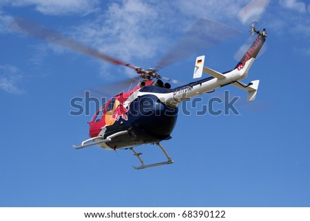 KECSKEMET, HUNGARY - AUGUST 17: Red Bull helicopter at the Kecskemet Airshow August 17, 2008 in Kecksemet, Hungary