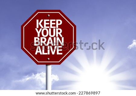 Keep Your Brain Alive written on red road sign with a sky background