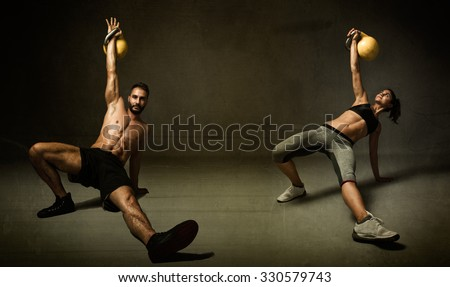 kettleball excercise for two persons, dark background