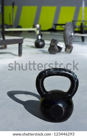 Kettlebell at fitness gym with lifting bars in background