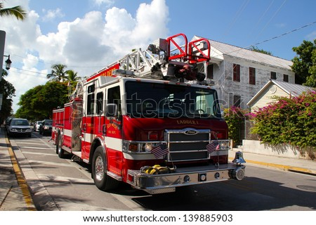 KEY WEST, FL - AUGUST 10: Key West's Fire Truck drives back to central after a false fire alarm. Soaring temperatures tr keep the fire brigade on high alert. August 10 2010, Key West, Florida.