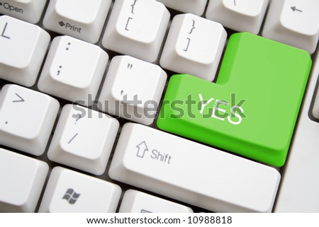 keyboard with green YES button