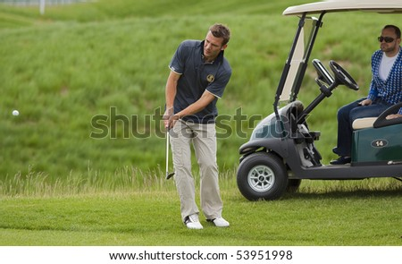 KHARKIV, UKRAINE - MAY 22: famous Ukrainian football player Andriy Shevchenko playing golf during Ukrainian National football team visit to Superior golf club, May 22, 2010 in Kharkov, Ukraine