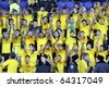 KHARKIV, UKRAINE - OCTOBER 30: Metalist fans support their team during FC Metalist Kharkiv vs. FC Obolon Kyiv football match, October 30, 2010 in Kharkov, Ukraine - stock photo