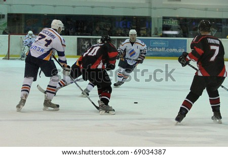 KHARKOV, UA - NOVEMBER 30: Shamanskiy No.10 (center) in action during HC Kharkov vs. Donbass (5:8) ice hockey match, November 30, 2010 in Kharkov, Ukraine