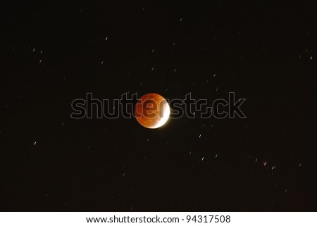 KHONKAEN, THAILAND - DEC. 10: lunar eclipse coinciding with the first day of winter is seen in the night sky on Dec. 10, 2011 Khonkaen, Thailand.