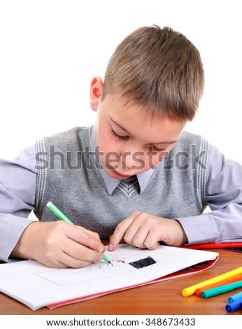 Kid Drawing at the School Desk Isolated on the White Background