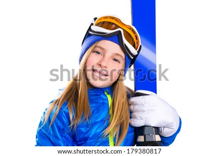 Kid girl ski with snow goggles and winter wool hat